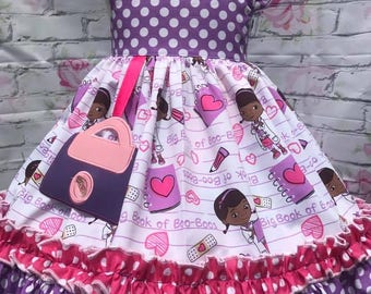 Doc McStuffins inspired dress with applique dangle