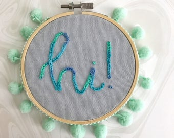 hi embroidery art with pom poms // cute wall art