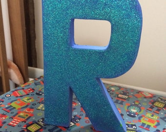 Glittery initial letter
