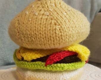 Hand knitted play food ... Burger with cheese, lettuce, ketchup & mustard with sesame seed topping.