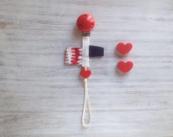 Love USA Organic Pacifier Clip with organic fabric tags and red heart motif bead. Nontoxic!