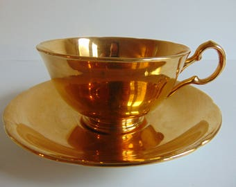 22k Gold Teacup and Saucer Set Royal Winton Grimwades English Bone China from the 1940's