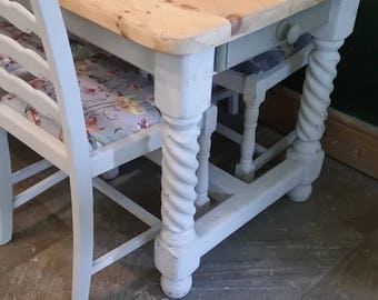 barley twist table and 4 chairs.