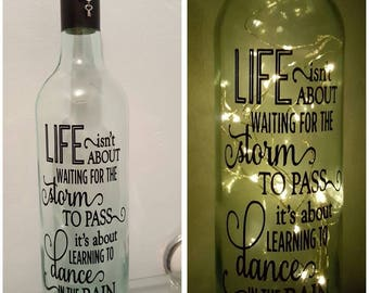 LED Light Up Bottle or Jar. Life Isn't about waiting for the storm to pass Quote.