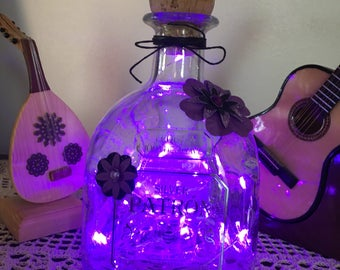 Patron liquor bottle with Purple patron LED lights with flower decorations. Gorgeous in person. Spectacular ambiance lighting