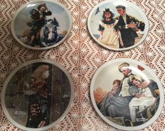 A wonderful set of 4 vintage Norman Rockwell decorative plates with hangers.