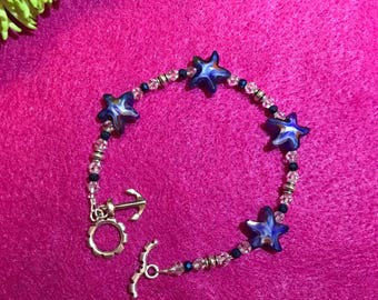 Blue glass star fish bracelet with toggle clasp