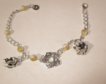 silver bracelet with ivory pearls with Ecru highlights and charms