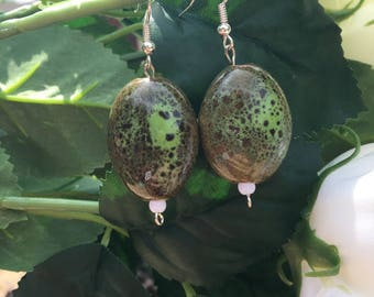 Dark and light green earrings with a touch of white