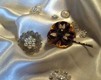 Flower hair clip thought in chocolate and gold small satin ribbon ivory petals with an acrylic heart.