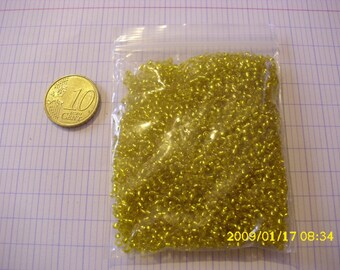 set of 20 grams of beads rocaielle 2mm transparent yellow glass