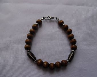 Mens bracelet, Brown, wooden beads, bone and stainless steel. Lobster clasp.