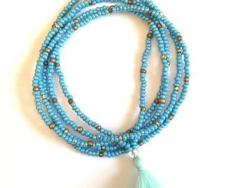 Necklace with seed beads in sky blue tassel.