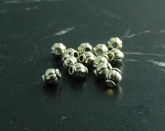 Antique set of 10 silver spacer beads