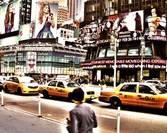 Yellow Cabs rushing past into Times Square, NYC