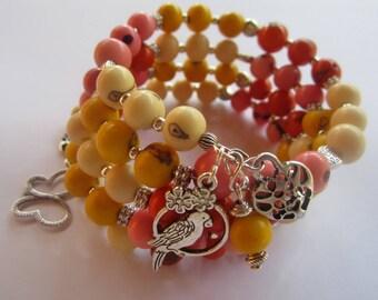 Silver charms and gorgeous acai shape memory bracelet