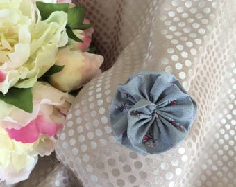 Gray fabric flower and pink flowers