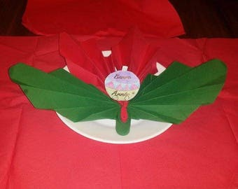 Christmas napkin folding in the shape of large wings