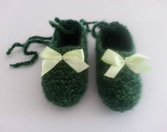 Small 3-9 months Heather Green feet raised(enhanced) by a tangy bow