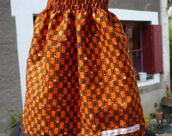 Orange wax smocked baby dress