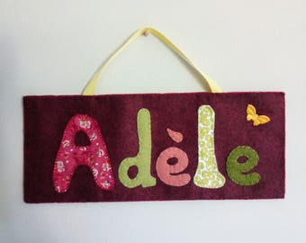 Door plate with felt and fabric
