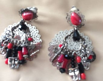 in shades of red and black clip earrings