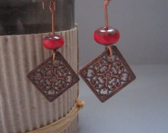 Red pearl earrings and copper ornament