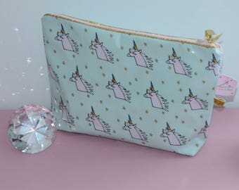 """Toiletry bag in coated cotton """"unicorns"""" and matching Gold piping"""