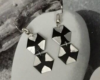 Earrings Pentagon capsule black and silver.