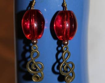 music treble clef bronze and Red bead earrings