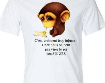 white t-shirt with a monkey and humorous text...