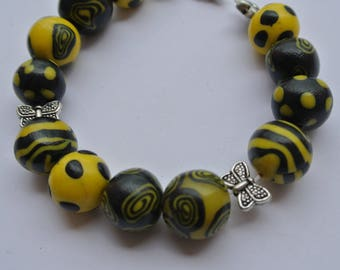 Bracelet beads yellow and black in spirals and polka dots