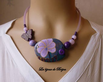 Short necklace with clay polymer, glass bead and purple and dark blue howlite