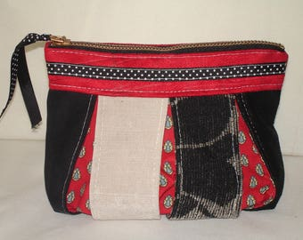 Bellows made of black and red fabric clutch