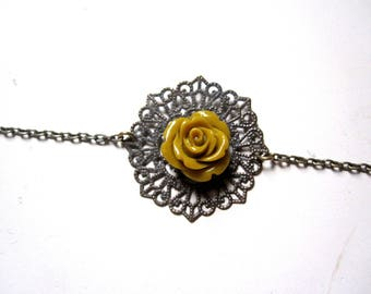Antique bronze headband and yellow flower