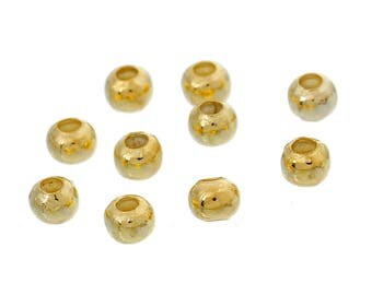 Smooth round spacer beads in golden metal.