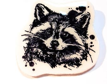 Polymer clay black and white raccoon brooch. Handmade in France