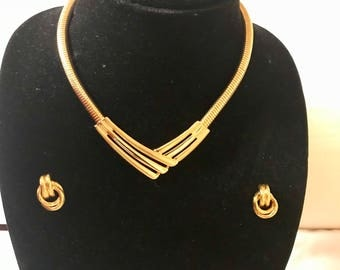 Gold statement necklace with matching earrings