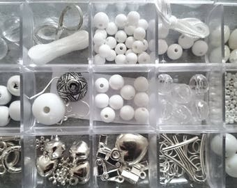 Kit for creations of jewels in the plastic box with lid