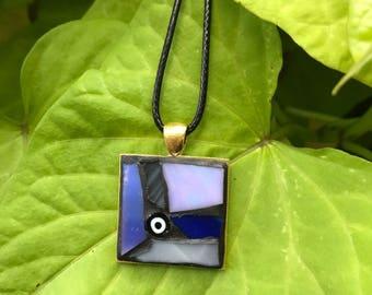 Blue art glass motif pendant