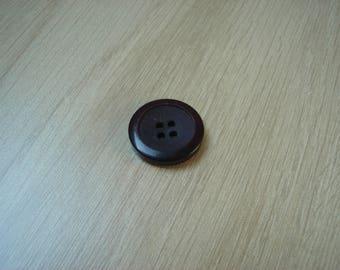 Burgundy round button hand transparency