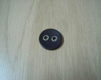 large dark purple round button