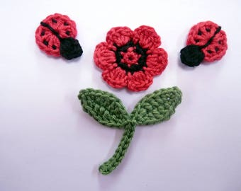 two little ladybugs and a flower - crochet applique