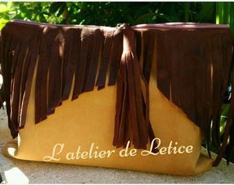 a beige and Brown fringe leather bag