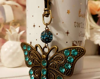 Keychain in the shape of butterfly with Rhinestones and shamballa bead