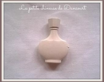 Plaster G bottle of perfume
