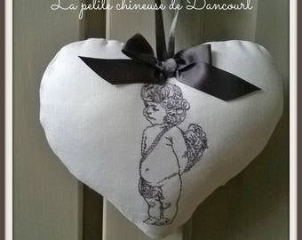 White heart with embroidered Cherub