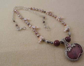 rhodonite and sterling silver wire woven pendant on a necklace of pearls, carved shell seahorses and sterling silver chain