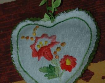 Green embroidered door pillow