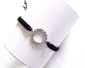 Macrame bracelet charm ring with a multitude of rhinestones and black thread